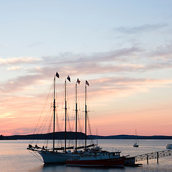 Sunrise in Bar Harbor near Maine's Acadia National Park.  Four-masted schooner, The Margaret Todd.