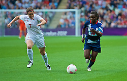 COVENTRY, ENGLAND - Friday, August 3, 2012: Canada's's Rhian Wilkinson (L) and Great Britain's's Eniola Aluko during the Women's Football Quarter-Final match between Great Britain and Canada, on Day 7 of the London 2012 Olympic Games at the Rioch Arena. Canada won 2-0. (Photo by David Rawcliffe/Propaganda)
