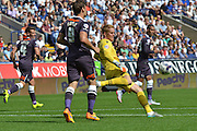 Ben Amos clears the ball upfield during the Sky Bet Championship match between Bolton Wanderers and Derby County at the Macron Stadium, Bolton, England on 8 August 2015. Photo by Mark Pollitt.