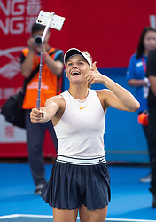October 14, 2018 - Hong Kong, China - Ukrainian teenager DAYANA YASTREMSKA takes a selfie as she celebrates winning the women's singles final match against top seed Wang Qiang at the 2018 Prudential Hong Kong Tennis Open WTA International tennis tournament in Victoria Park. (Credit Image: © Jayne Russell/ZUMA Wire)