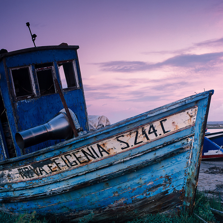 An old fishing boat lies grounded at the fishing harbour of Carrasqueira, a small fishing village south of the Troia peninsula