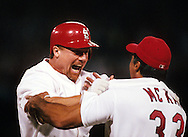 "ST. LOUIS, MO-SEPTEMBER 8:   Mark McGwire #25 of the St. Louis Cardinals celebrates with first base coach Dave McKay after hitting his 62nd home run of the season, breaking the single season home run record held by Roger Maris in 1961, on September 8, 1998 at Busch Stadium in St. Louis, Missouri.  The summer of 1998 what has been called the ""Great Home Run Race of 1998"".  McGwire and Sammy Sosa were both attempting to break the single season home run record of 61 held by Roger Maris since 1961.(Photo by Ron Vesely"