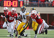 November 25, 2011: Iowa Hawkeyes running back Marcus Coker (34) tries to avoid Nebraska Cornhuskers defensive end Jason Ankrah (9) on a run during the first half of the NCAA football game between the Iowa Hawkeyes and the Nebraska Cornhuskers at Memorial Stadium in Lincoln, Nebraska on Friday, November 25, 2011. Nebraska defeated Iowa 20-7.