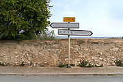 weathered traffic direction signs in Bages France