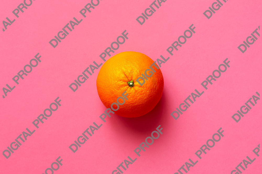 Fresh orange fruit isolated on fuscia background viewed from above, flatlay style.  Close-up.