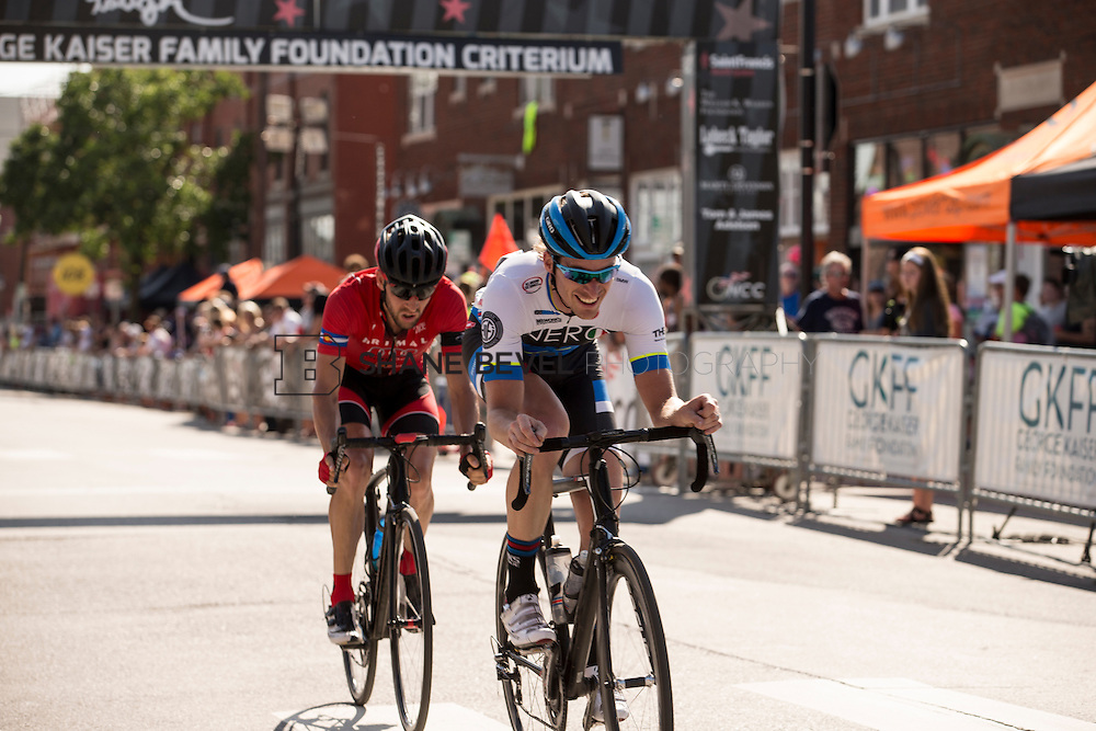 6/13/15 5:19:48 PM -- Racers pass by the crowds in the criterium races in the Brady Arts District on Saturday afternoon of Tulsa Tough. <br /> <br /> Photo by Shane Bevel