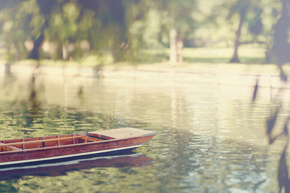 a lonely punt sitting on the River Cam, Cambridge on a summer's afternoon