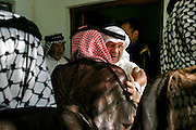 Malik Al-kasid greets male relatives before the return to his home village Soug Al-Sheuk on the outskirts of Nasiriya, Iraq, Tuesday, July 29, 2003. The Al-kasid family fled Iraq after the Gulf War and their part in the uprising against Saddam Hussein in 1991, spent 3 years in Rafha, Saudi Arabia and finally settled in Dearborn, MI. The family hasn't been home to Iraq in 13 years.