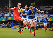 Portsmouth defender Matt Clarke beats Leyton Orient Midfielder Kevin Nolan to the ball during the Sky Bet League 2 match between Portsmouth and Leyton Orient at Fratton Park, Portsmouth, England on 6 February 2016. Photo by Adam Rivers.
