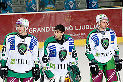 Bostjan Golicic, Matija Pintaric and Matej Hocevar of HDD Tilia Olimpija greets fans during ice-hockey match between HDD Tilia Olimpija and EHC Liwest Black Wings Linz in 19th Round of EBEL league, on November 7, 2010 at Hala Tivoli, Ljubljana, Slovenia. (Photo By Matic Klansek Velej / Sportida.com)