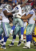 Dallas Cowboys running back Darren McFadden (20) jumps and celebrates with Dallas Cowboys offensive guard La'el Collins (71) and other teammates after running for a 6 yard late fourth quarter touchdown that gives the Cowboys a 16-9 lead during the 2015 week 13 regular season NFL football game against the Washington Redskins on Monday, Dec. 7, 2015 in Landover, Md. The Cowboys won the game 19-16. (©Paul Anthony Spinelli)