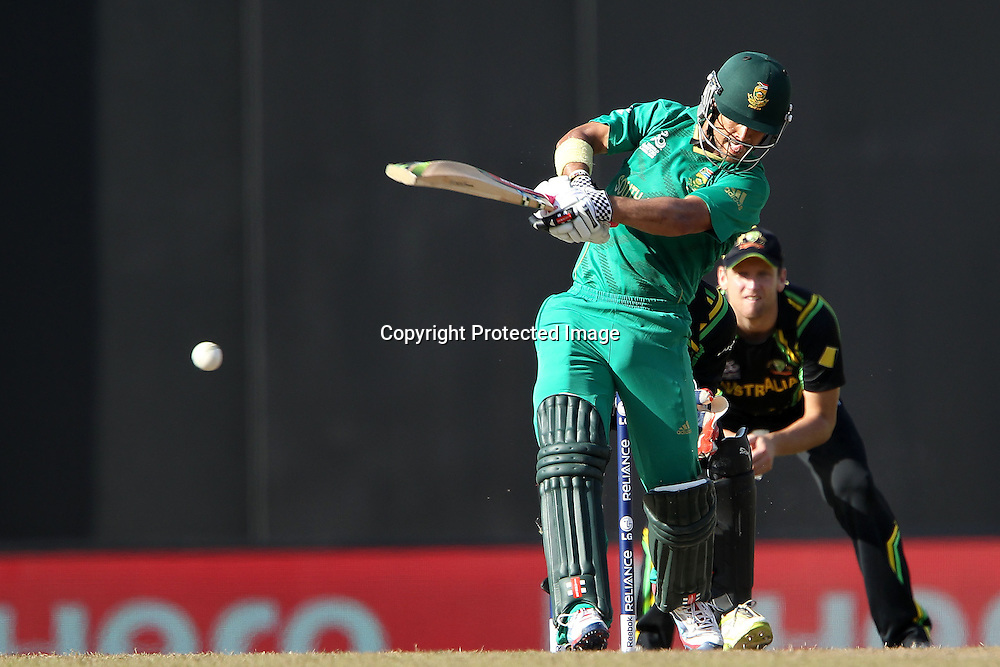 JP Duminy knocks Brad Hoggfor four during the ICC World Twenty20 Super 8s match between Australia and South Africa held at the Premadasa Stadium in Colombo, Sri Lanka on the 30th September 2012<br /> <br /> Photo by Ron Gaunt/SPORTZPICS