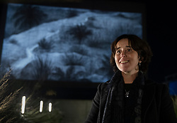 © Licensed to London News Pictures. 26/09/2018. Artist Epoh Beech's stands in front of a projection of her hand drawn animated film 'The Masque of Blackness' at The National Theatre for Totally Thames 2018.  The projection is showing from Thursday 27 – Saturday 29 September from 8pm to 11pm and forms part of the annual celebration of the River Thames - a creative and diverse season of events that inspires, connects and enthrals throughout the month of September - curated and managed by the Thames Festival Trust. Photo credit: Peter Macdiarmid/LNP
