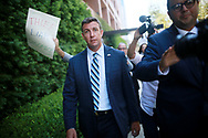 """SAN DIEGO, CA-AUG 23: Congressman Duncan Hunter walks out of the San Diego Federal Courthouse after an arraignment hearing on Thursday, August 23, 2018 in San Diego, CA.  Hunter and his wife Margaret, who pled """"not guilty"""", are accused of using more than 250,000 in campaign funds for personal use.(Photo by Sandy Huffaker/Getty Images)"""