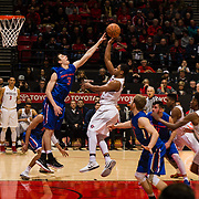 27 February 2018: San Diego State men's basketball hosts Boise State in their last meet up of the regular season at Viejas Arena. San Diego State Aztecs forward Matt Mitchell (11) attempts a jump shot in the paint over Boise State Broncos guard Justinian Jessup (3) in the second half. The Aztecs beat the Broncos 72-64.  <br /> More game action at sdsuaztecphotos.com