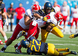 Sep 10, 2016; Morgantown, WV, USA; West Virginia Mountaineers defensive lineman Noble Nwachukwu (97) tackles Youngstown State Penguins running back Martin Ruiz (29) during the second quarter at Milan Puskar Stadium. Mandatory Credit: Ben Queen-USA TODAY Sports