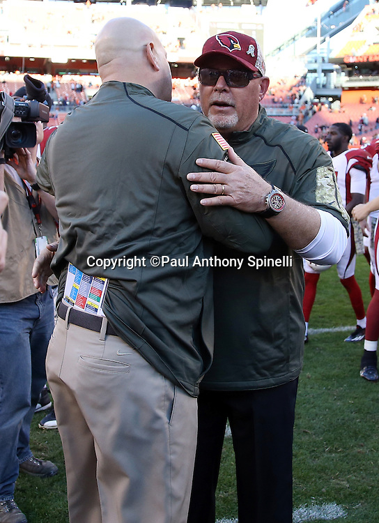 (R-L) Arizona Cardinals head coach Bruce Arians hugs Cleveland Browns head coach Mike Pettine after the 2015 week 8 regular season NFL football game against the Cleveland Browns on Sunday, Nov. 1, 2015 in Cleveland. The Cardinals won the game 34-20. (©Paul Anthony Spinelli)