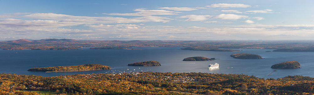 A cruise ship pulls into Frenchman Bay in this fall panorma of Bar Harbor on Mount Desert Island, Maine, USA