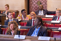 © Licensed to London News Pictures. 22/10/2018. Bristol, UK. Global Parliament of Mayors Annual Summit, 21-23 October 2018, at Bristol City Hall. Picture of GRACE MARY MUGASA, Mayor of Hoima, Uganda, taking part in the plenary session on harnessing the power of migration. The Global Parliament of Mayors 2018 is the biggest and most ambitious Annual Summit to date. GPM Bristol 2018 will host up to 100 global mayors for an action-focused summit that addresses some of the biggest challenges facing today's world cities. GPM Bristol 2018's theme, Empowering Cities as Drivers of Change, will focus minds on global governance and the urgent need for the influence, expertise and leadership of cities to be felt as international policy is shaped. GPM Bristol 2018 will provide mayoral delegates with a global network of connections and a space to develop the collective city voice necessary to drive positive change. The programme will engage participants in decision-making, with panels, debate and voting on priority issues including migration and inclusion, urban security and health, and is a unique chance to influence decisions on the most pressing issues of our time. Photo credit: Simon Chapman/LNP