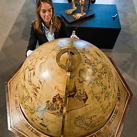 London January 14th A Bonhams employee with a  Vincenzo Coronelli terrestrial globe measuring 108cm that  will go under the hammer at the annual BonhamsThe  Gentlemen's Library Sale on January 20th....***Agreed Fee's Apply To All Image Use***.Marco Secchi /Xianpix. tel +44 (0) 771 7298571. e-mail ms@msecchi.com .www.marcosecchi.com