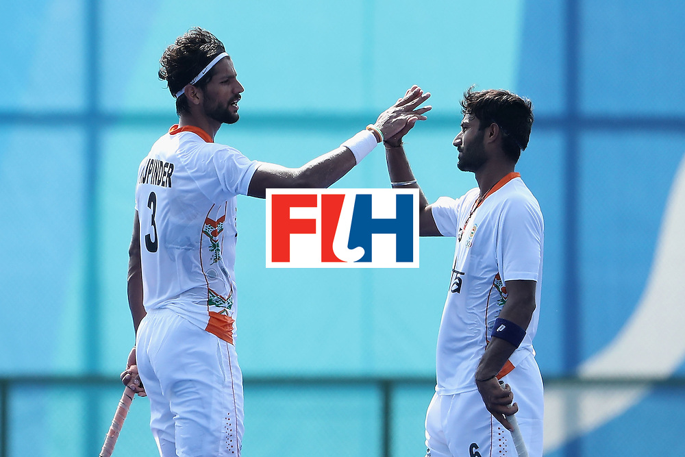 RIO DE JANEIRO, BRAZIL - AUGUST 09:  Rupinder Pal Singh #3 and Surender Kumar #6 of India celebrate after defeating Argentina 2-1 following the hockey game on Day 4 of the Rio 2016 Olympic Games at the Olympic Hockey Centre on August 9, 2016 in Rio de Janeiro, Brazil.  (Photo by Christian Petersen/Getty Images)