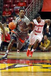 17 December 2014: Twymond Howard hustles the ball up the floor shadowed by Paris Lee during an NCAA Men's Basketball game between the Skyhawks of University of Tennessee - Martin and the Redbirds of Illinois State at Redbird Arena in Normal Illinois