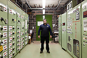Paul Newman, an employee at the SITA landfill site. He works in the compressor house where gas from the landfill is eventually converted into electricity. Packington, Warwickshire, UK. 2011