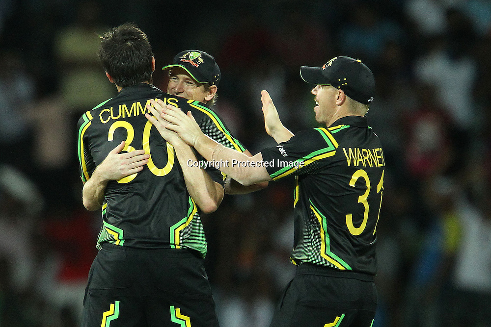 Pat Cummins, George Bailey (Captain) and David Warner celebrate the wicket of Mahendra Singh Dhoni (Captain) during the ICC World Twenty20 Super 8s match between Australia and India held at the Premadasa Stadium in Colombo, Sri Lanka on the 28th September 2012<br /> <br /> Photo by Ron Gaunt/SPORTZPICS