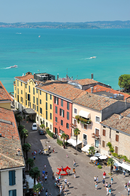 The holiday resort town of Sirmione on Lake Garda, Lombardy, Italy. From the castle over Piazza Castello to Lago di Garda.