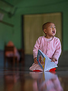Studies Loud, And Ssndar, 5 years old, , Padonmar Sari Nunnery, Nyaung Shwe, Inle Lake, Myanmar