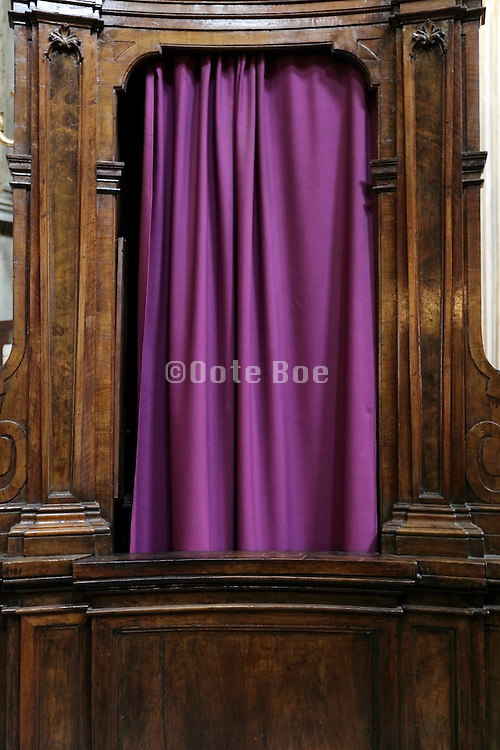 closed curtains of a confessional