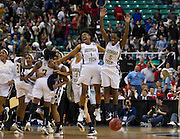 Georgia Tech's Dawnn Maye (1) and Metra Walthour (5) celebrate after their close win over North Carolina in the 2012 ACC Women's Basketball Tournament in Greensboro, North Carolina.  Georgia Tech won 54 - 53.  March 02, 2012  (Photo by Mark W. Sutton)