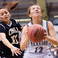 021613       Cable Hoover<br /> <br /> Tuba City Warrior Shauntee Chee (12) evades the reach of Chinle Wildcat Brittany Yazzie (11) during the Arizona State Tournament at the NAU Walkup Skydome in Flagstaff Saturday.