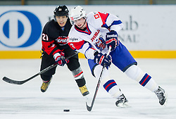 Shuhei Kuji of Japan vs Ziga Jeglic of Slovenia during ice-hockey match between Slovenia and Japan at IIHF World Championship DIV. I Group A Slovenia 2012, on April 16, 2012 in Arena Stozice, Ljubljana, Slovenia. Slovenia defeated Japan 4-2. (Photo by Vid Ponikvar / Sportida.com)