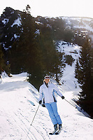 Woman skiing down slope elevated view