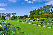 Garden at Ballymaloe Cookery School with Gothic style summer house and perennial borders, County Cork, Ireland