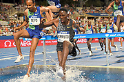 Conseslus Kipruto (KEN) and Chala Beyo (ETH) race over the water jump in the steeplechase during the Meeting de Paris, Saturday, Aug. 24, 2019, in Paris. (Jiro Mochizuki/Image of Sport via AP)