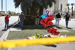 FBI sweep the area close to a makeshift memorial inside the perimeter of a police barricade on the Las Vegas Strip Tuesday, Oct. 3, 2017, in Las Vegas. A mass shooting occurred late Sunday evening nearby at a music festival. (Photo by Ronda Churchill/ZUMA Press)