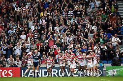 The Japan team celebrate a try from Ayumu Goromaru - Mandatory byline: Patrick Khachfe/JMP - 07966 386802 - 19/09/2015 - RUGBY UNION - Brighton Community Stadium - Brighton, England - South Africa v Japan - Rugby World Cup 2015 Pool B.