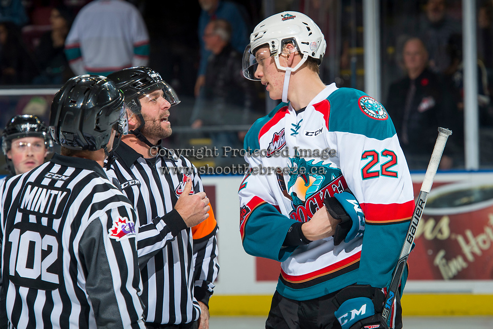 KELOWNA, CANADA - NOVEMBER 11: Braydyn Chizen #22 of the Kelowna Rockets stands at centre ice and speaks to referee Reagan Vetter against the Red Deer Rebels on November 11, 2017 at Prospera Place in Kelowna, British Columbia, Canada.  (Photo by Marissa Baecker/Shoot the Breeze)  *** Local Caption ***