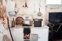 CETARA, ITALY - 10 March 2014: A pot is heated in the kitchen in the farmhouse of Antonio Polverino, a 64 years old peasant living and working in Cetara, a village of fishermans in the Amalfi Coast, Italy, on March 10th 2014.<br /> Antonio Polverino was interviewed by Daniele De Michele, aka Donpasta, a DJ-economist with a passion for gastronomy.