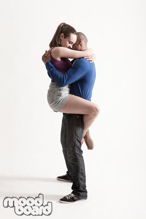 Modern dance couple embrace