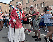Italy, Siena, the Palio:  both the horse and the Jockey are  taken to the duomo where thousands of supporters and fan are waiting to celebrate and sing the Deum  in thanksgiving
