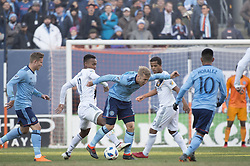 March 11, 2018 - Bronx, New York, United States - New York City FC defender ANTON TINNERHOLM (3) fights to control the ball from Los Angeles Galaxy forward OLA KAMARA (11) while New York City FC midfielder ALEXANDER RING (8) and New York City FC midfielder MAXIMILIANO MORALEZ (10) look on during a regular season match at Yankee Stadium in Bronx, NY.  NYCFC defeats LA Galaxy 2 to 1. (Credit Image: © Mark Smith via ZUMA Wire)