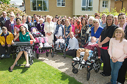 In the image - The Duchess in a group picture with patients staff and family members.<br /> HRH The Duchess of Cornwall, Patron of Helen & Douglas House Hospice visits Douglas House to celebrate their 10th Anniversary. The Hospice cares for children and young adults with life shortening conditions, United Kingdom, Friday, 9th May 2014. Picture by i-Images