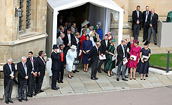 Queen Elizabeth II and the Duke of Edinburgh leave St George's Chapel, Windsor Castle, with members of the Royal Family following the wedding of Princess Eugenie to Jack Brooksbank.