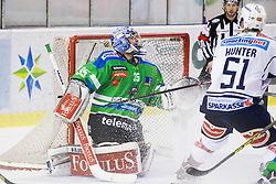 13.09.2015, Hala Tivoli, Ljubljana, SLO, EBEL, HDD Telemach Olimpija Ljubljana vs EC VSV, 2. Runde, in picture Roy Olivier (HDD Telemach Olimpija, #35) and Eric Hunter (EC VSV, #51) during the Erste Bank Icehockey League 2. Round between HDD Telemach Olimpija Ljubljana and EC VSV at the Hala Tivoli, Ljubljana, Slovenia on 2015/09/13. Photo by Urban Urbanc / Sportida