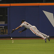 Right fielder Justin Maxwell, San Francisco Giants, misses a fly ball during the New York Mets Vs San Francisco Giants MLB regular season baseball game at Citi Field, Queens, New York. USA. 11th June 2015. Photo Tim Clayton