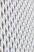 Windows of an office building form a pattern