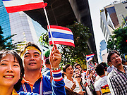 """20 DECEMBER 2013 - BANGKOK, THAILAND:  Anti-government protestors gather on Silom Road. Thousands of anti-government protestors, supporters of the so called Peoples Democratic Reform Committee (PRDC), jammed the Silom area, the """"Wall Street"""" of Bangkok, Friday as a part of the ongoing protests against the caretaker government of Yingluck Shinawatra. Yingluck dissolved the Thai Parliament earlier this month and called for national elections on Feb. 2, 2014. The protestors want the elections postponed and the caretaker government to step down. The Thai election commission ruled Friday that the election would go on dispite the protests.         PHOTO BY JACK KURTZ"""